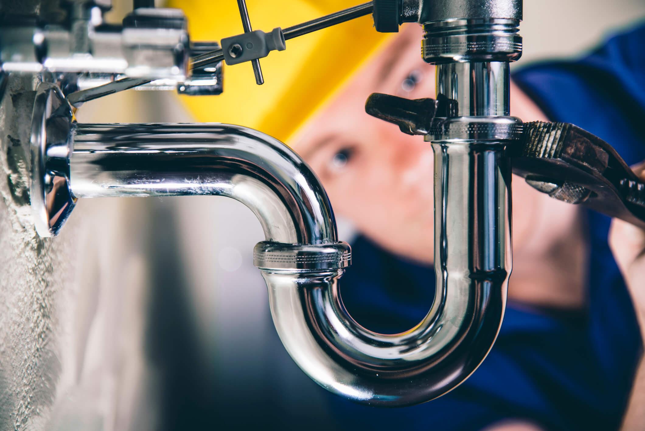 Eastern Idaho Plumber fixing plumbing under a sink
